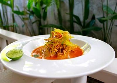 Chef Tammasak Chootong's Steamed Salmon Wrapped in Rice Noodles, Served with Yellow Curry from Chiangmai