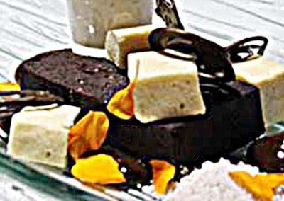 Chef Andrew McCrea's Composition of Liquorice Sambuca Fudge, Anise Sherbet, Liquorice Gel & Chai Milk